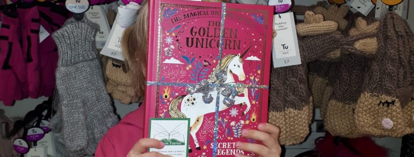 the book fairies hide books all around the UK - the golden unicorn book hidden by children