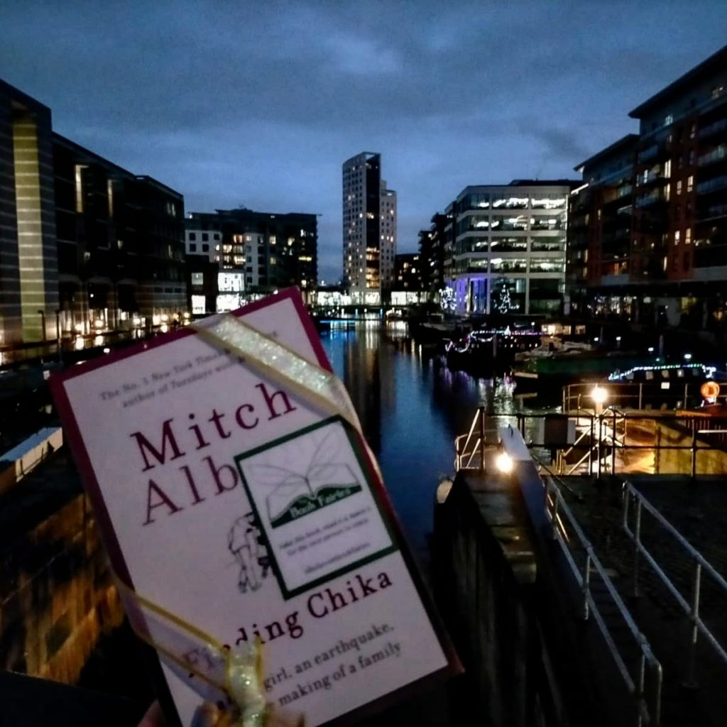 Hiding at the docks - Book Fairies hide copies of Mitch Albom novel Finding Chika