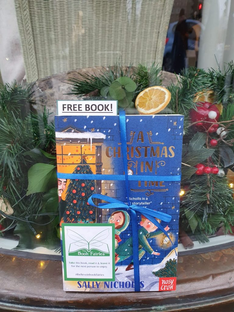 hidden at a christmas display - The Book Fairies hide copies of A Christmas in Time with Nosy Crow Publishing