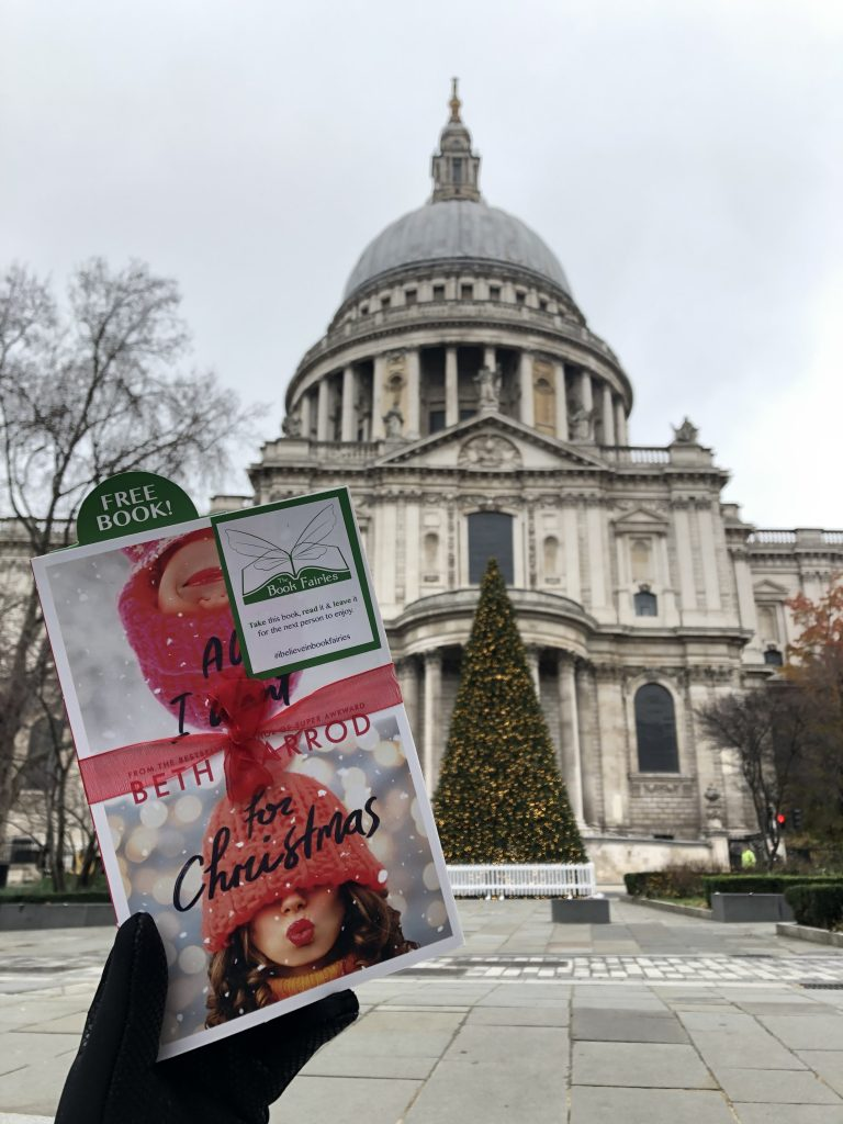 Hiding at St Pauls in London - Book Fairies hide copies of All I Want For Christmas by Beth Jarrod