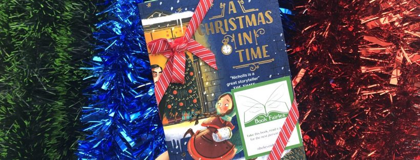 Hidden in tinsel - The Book Fairies hide copies of A Christmas in Time with Nosy Crow Publishing