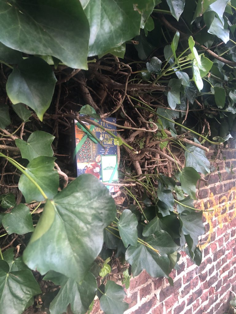 hiding along the canal - The Book Fairies hide copies of A Christmas in Time with Nosy Crow Publishing