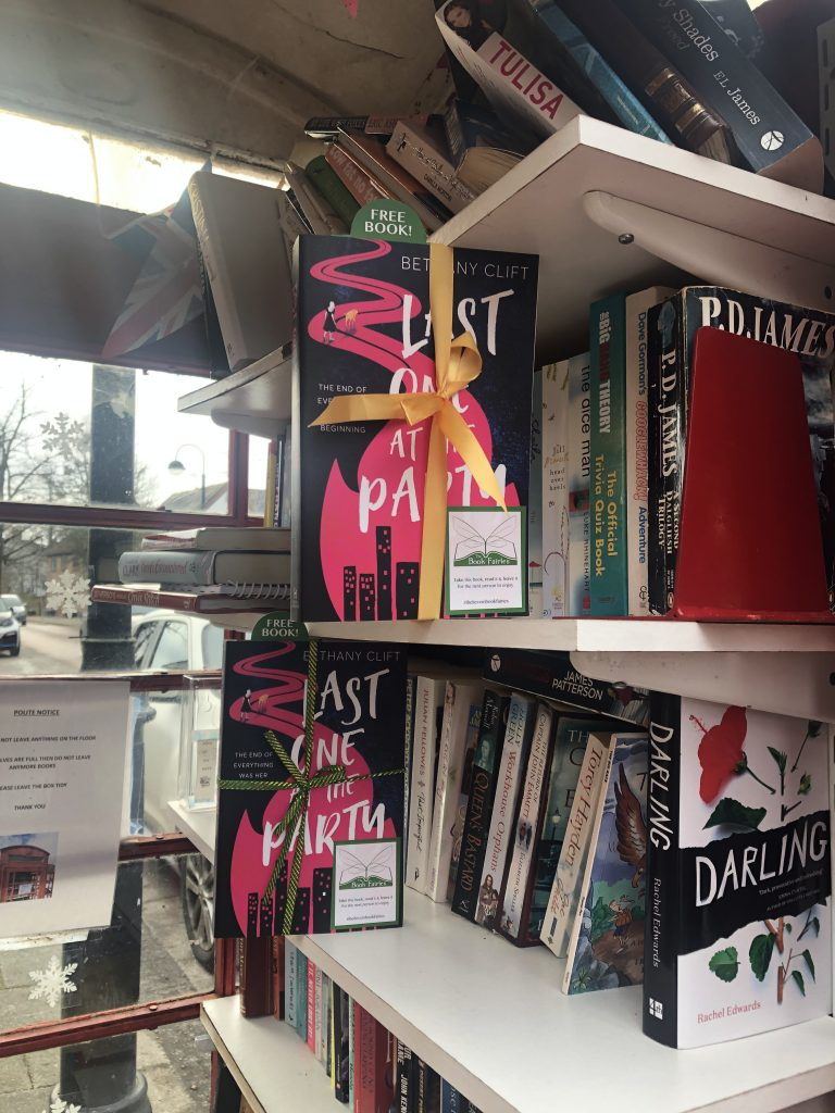 A phonebox library has two copies of Last One At The Party by Bethany Clift hidden by book fairies in Hampshire UK
