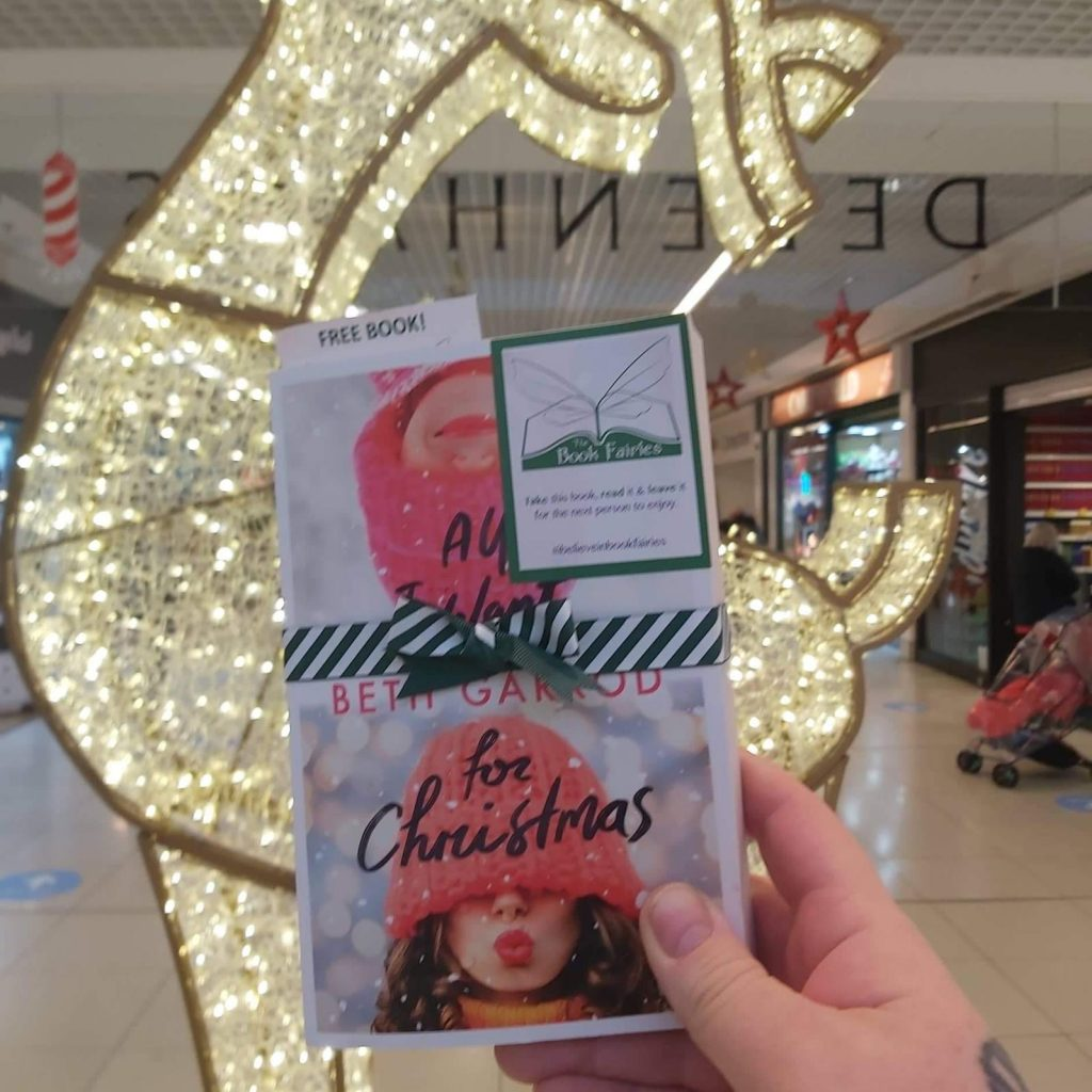 Hiding in a shopping mall - Book Fairies hide copies of All I Want For Christmas by Beth Jarrod
