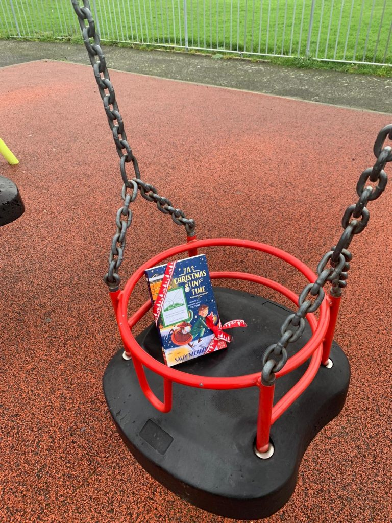 hidden in a playground - The Book Fairies hide copies of A Christmas in Time with Nosy Crow Publishing