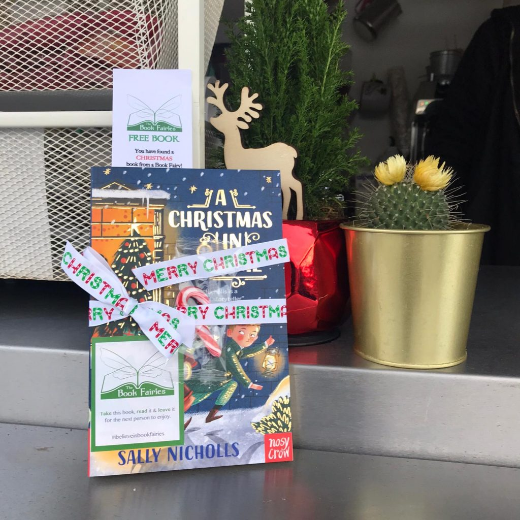 hidden at a garden centre - The Book Fairies hide copies of A Christmas in Time with Nosy Crow Publishing