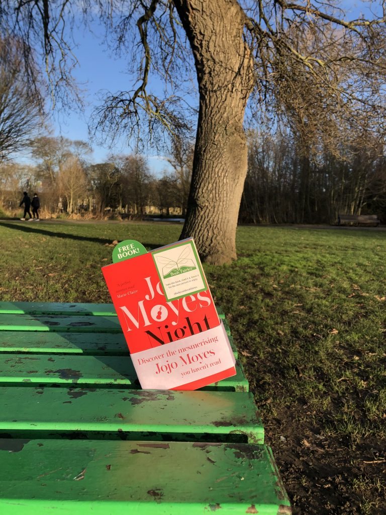 hiding on a bench - The Book Fairies hide copies of JoJo Moyes' Night Music