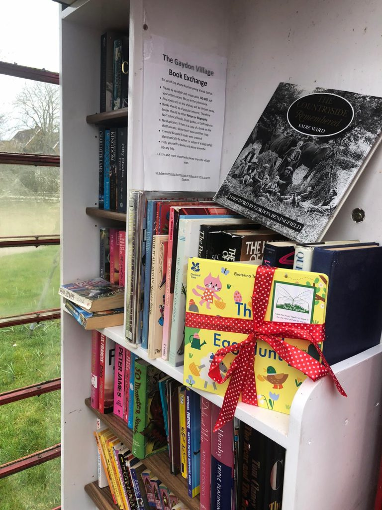 Hiding in a telephone booth library - Book fairies hide copies of National Trust title 'The Great Big Easter Hunt'