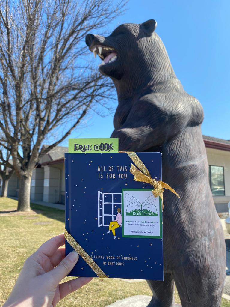 Hiding at a statue in Idaho: Book Fairies hide copies of All Of This Is For You by Ruby Jones