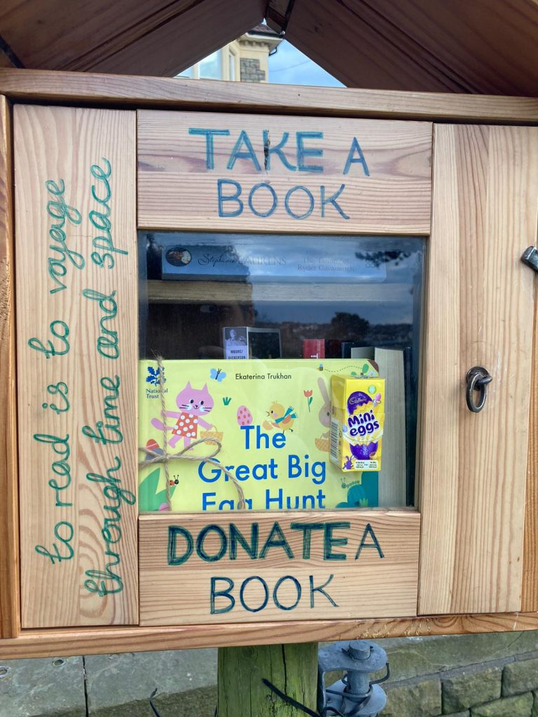 Hiding in a mini library - Book fairies hide copies of National Trust title 'The Great Big Easter Hunt'