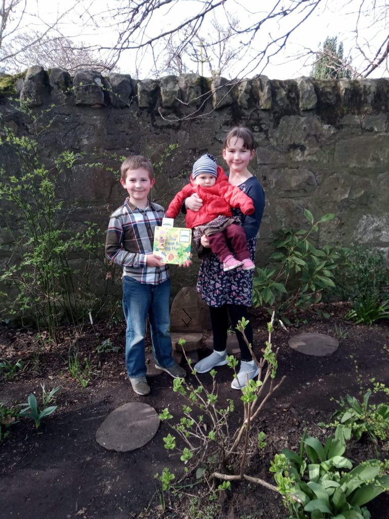 Happy family of book finders - Book fairies hide copies of National Trust title 'The Great Big Easter Hunt'