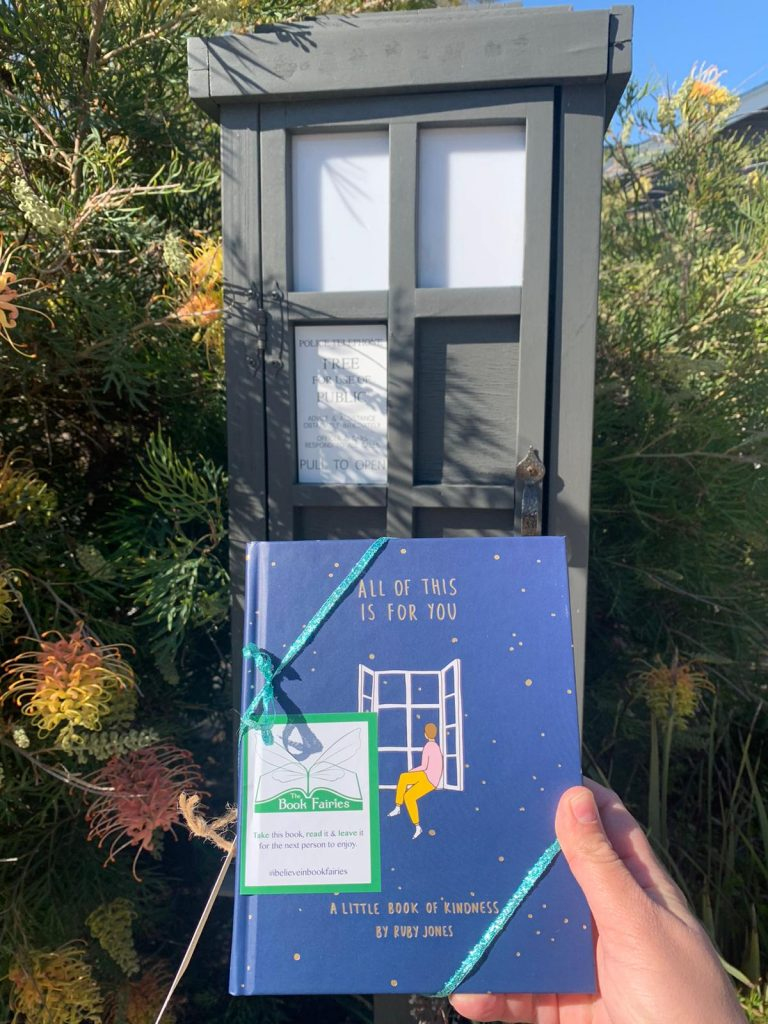 Hiding at a phone box library - Book Fairies hide copies of All Of This Is For You by Ruby Jones