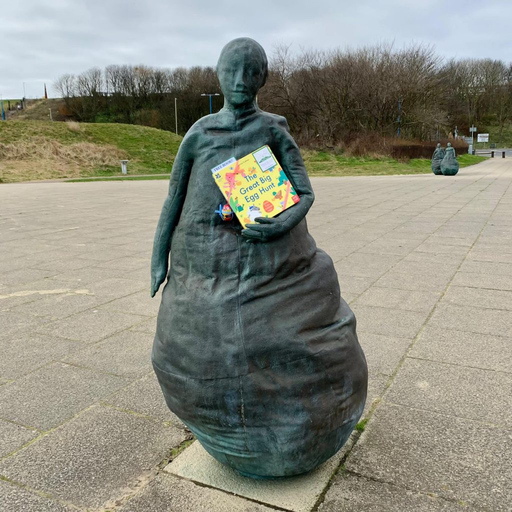 Hiding at a sculpture - Book fairies hide copies of National Trust title 'The Great Big Easter Hunt'