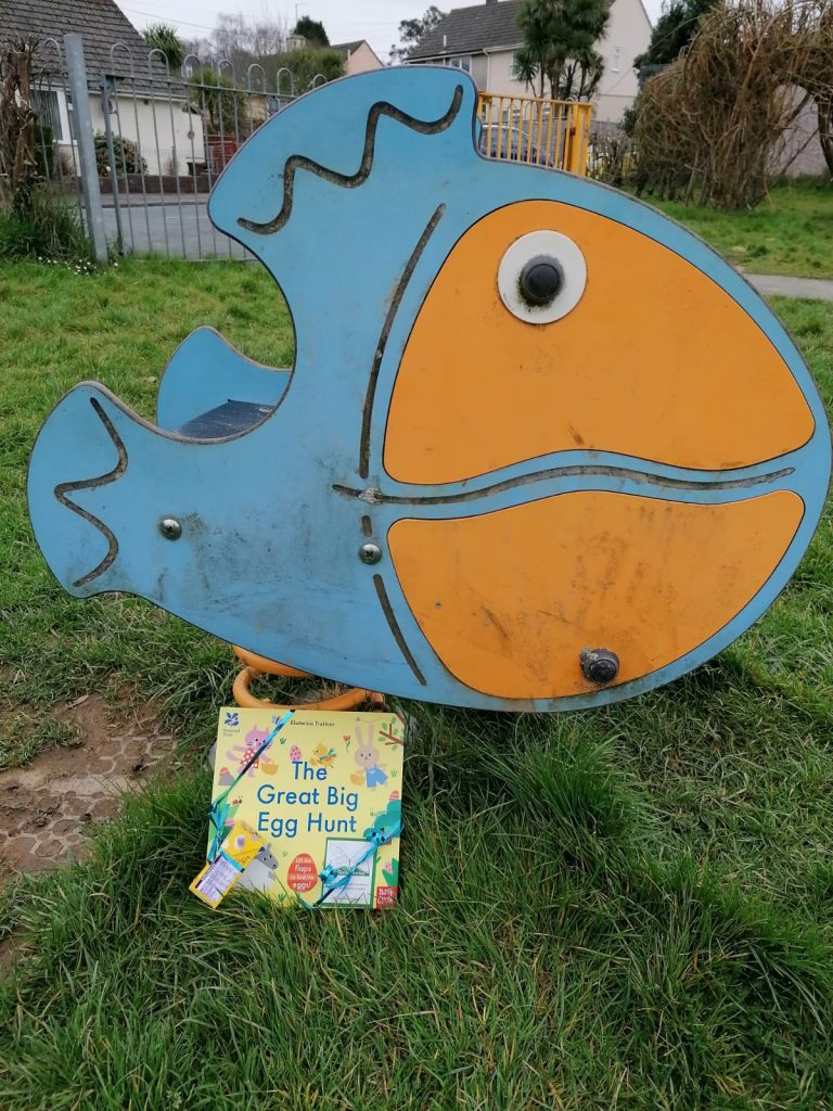 Hiding in a playground - Book fairies hide copies of National Trust title 'The Great Big Easter Hunt'