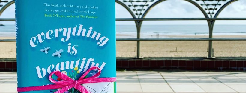 On a pier in South Shields - Book Fairies hide copies of Everything is Beautiful by Eleanor Ray