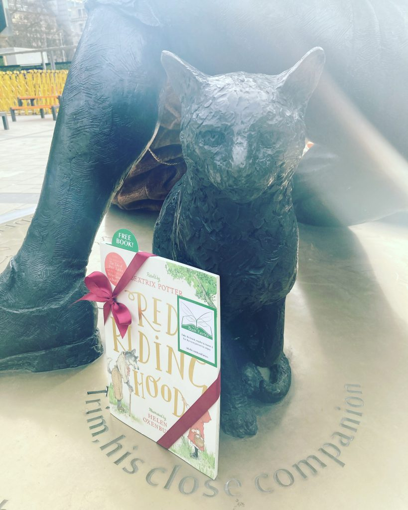 Hiding at Euston Station - Book Fairies hide copies of Red Riding Hood by Beatrix Potter and Helen Oxenbury