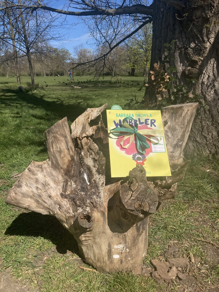 Hiding in a London park - Book Fairies hide Barbara Throws A Wobbler from Puffin Books