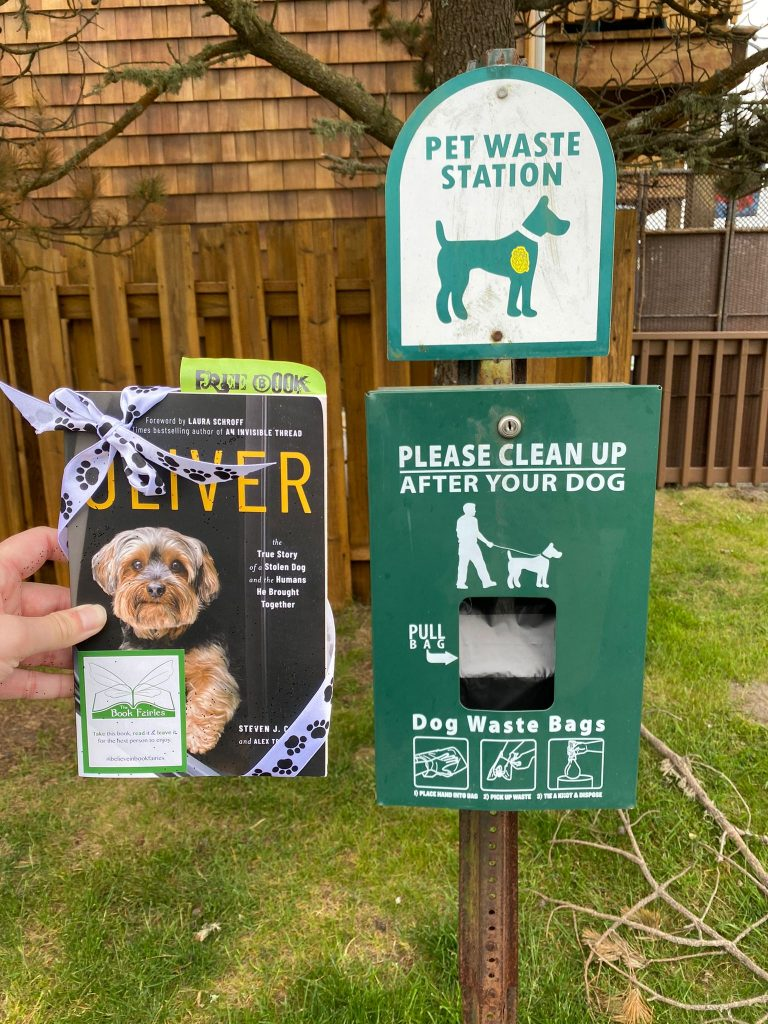 At a pet waste station! Book Fairies around the states hide copies of Oliver the dog