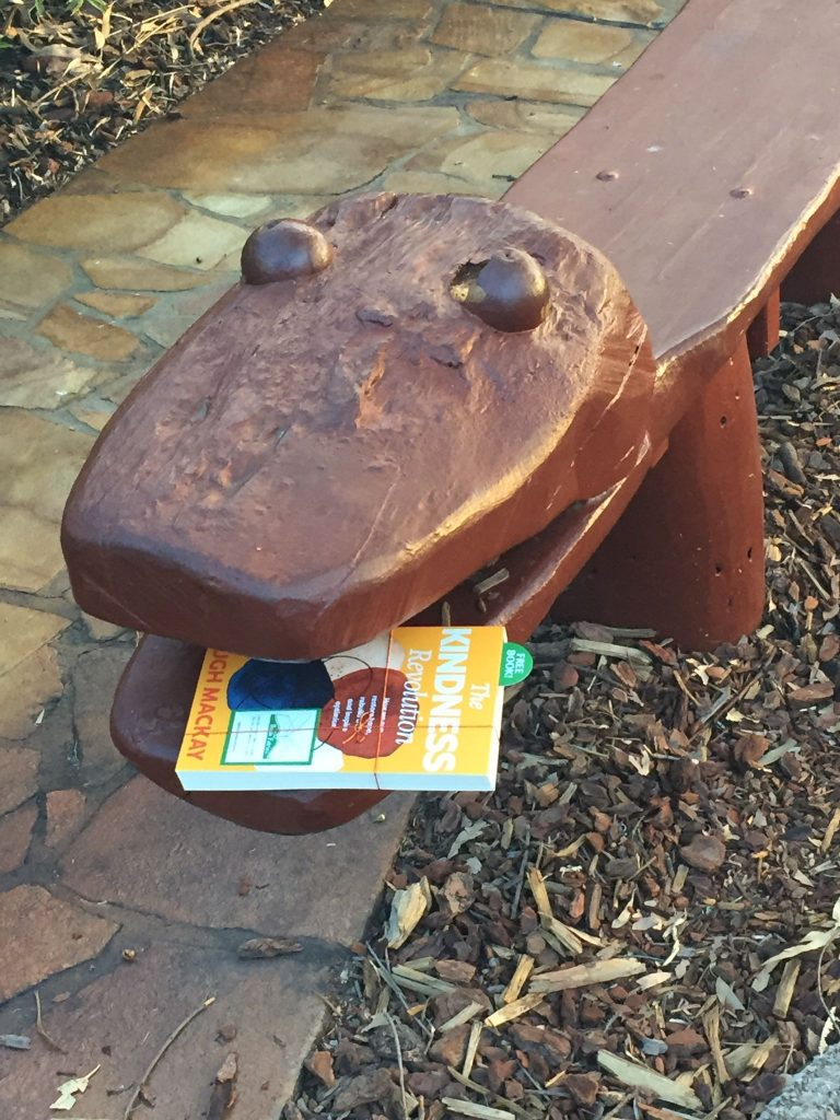 At a bench - The Book Fairies in Australia hide copies of The Kindness Revolution
