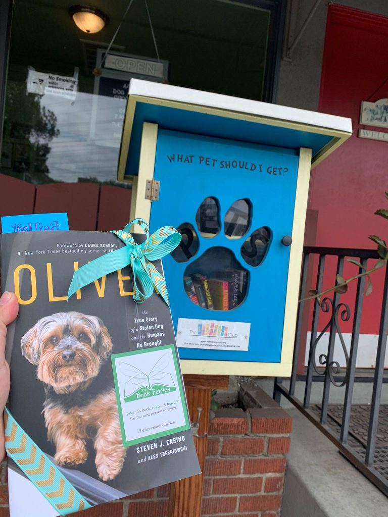 At a dog little free library - Book Fairies around the states hide copies of Oliver the dog