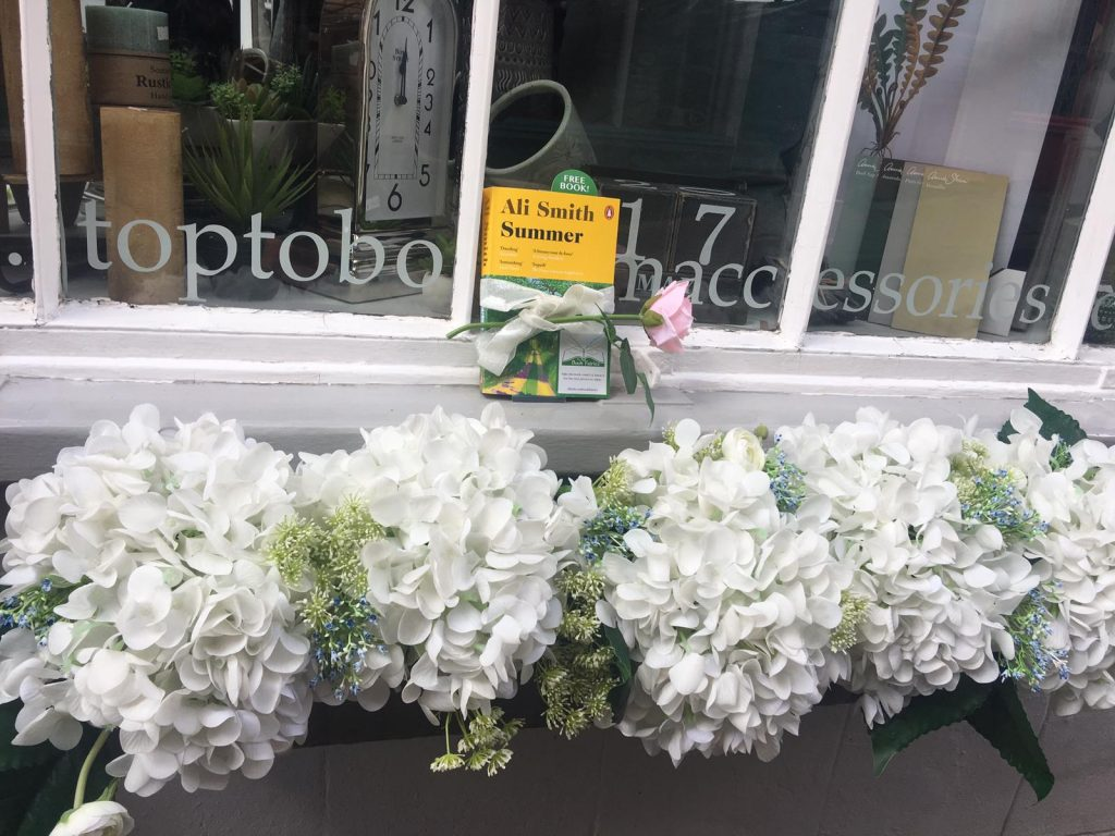 Book Fairies hide copies of Summer by Ali Smith at a pretty shop
