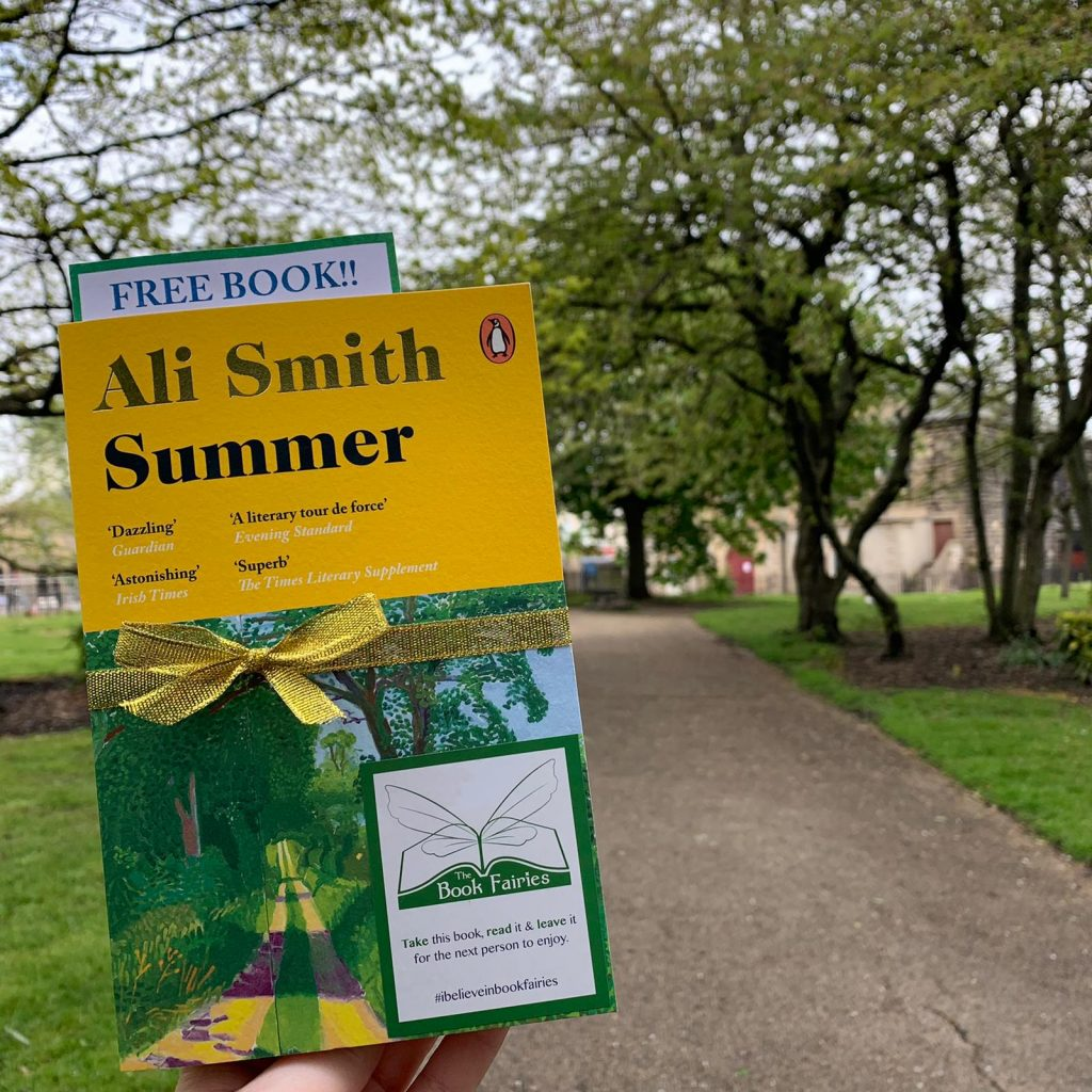 Book Fairies hide copies of Summer by Ali Smith in a beautiful park