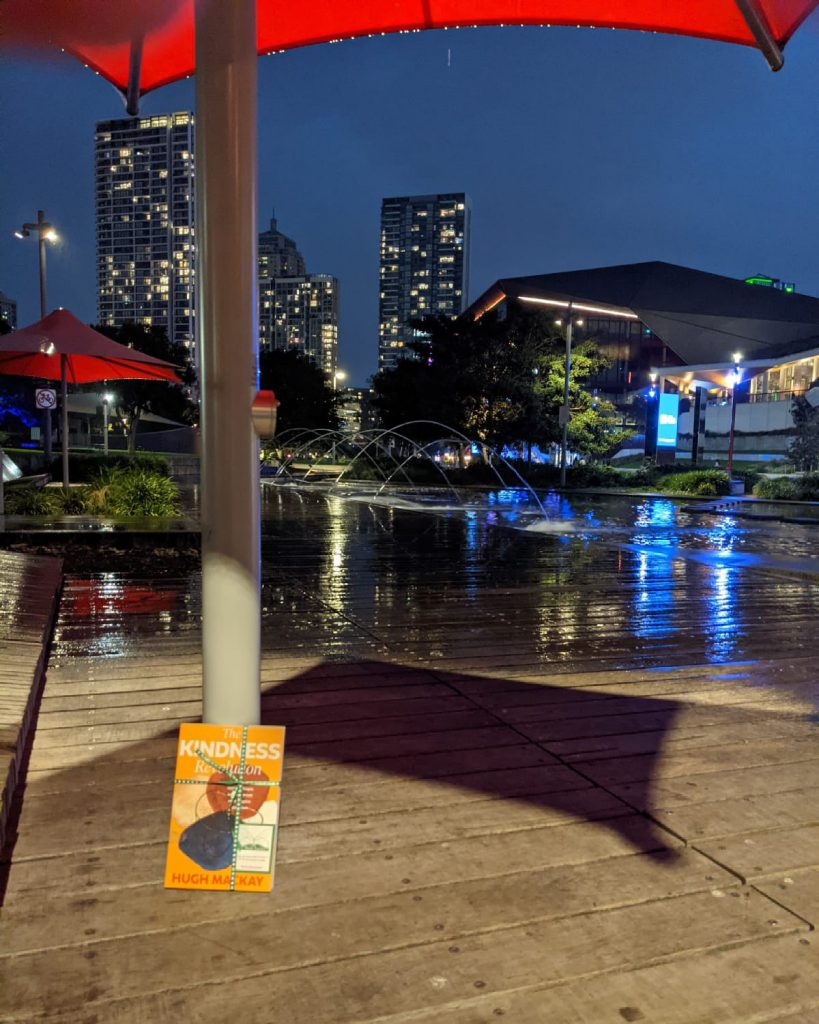 Sheltered from the rain in Sydney - The Book Fairies in Australia hide copies of The Kindness Revolution