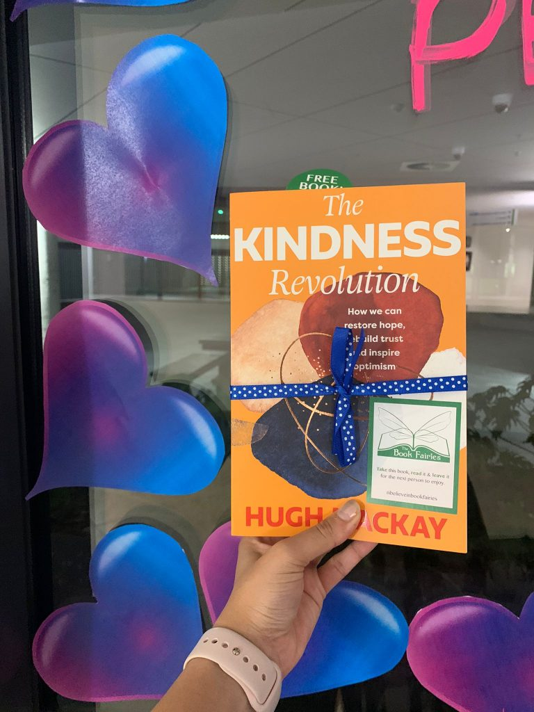 By a beautiful window display - The Book Fairies in Australia hide copies of The Kindness Revolution