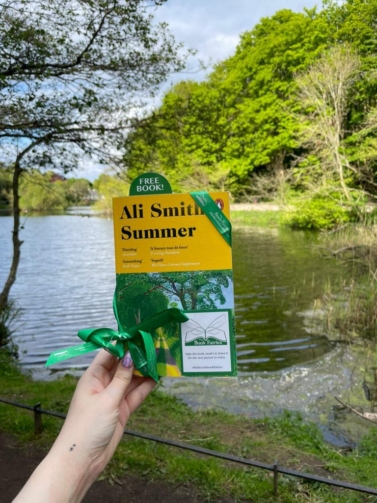 At a lake - Book Fairies hide copies of Summer by Ali Smith