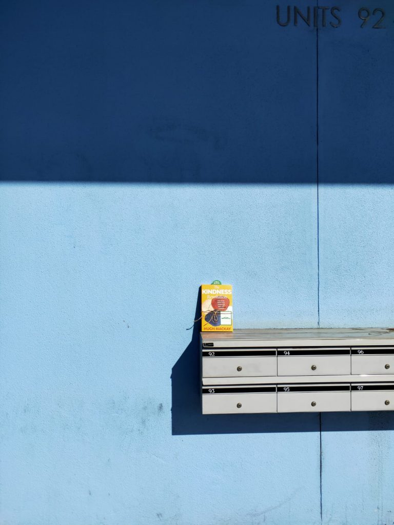 At a block wall - The Book Fairies in Australia hide copies of The Kindness Revolution