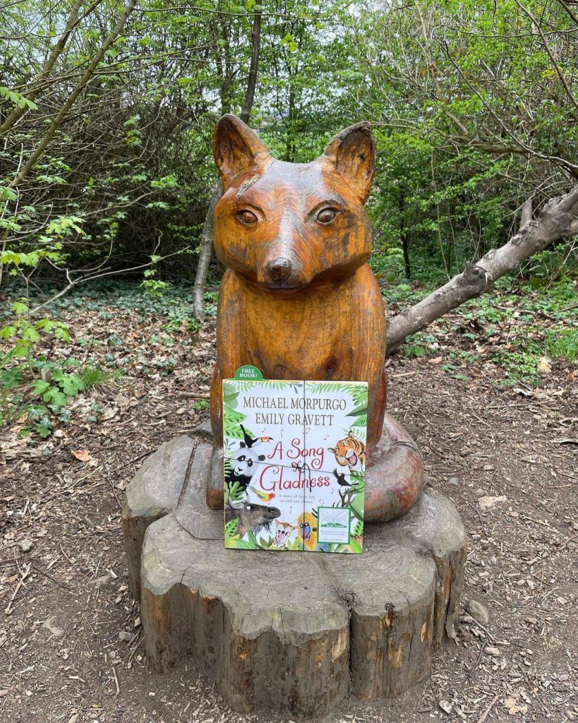At a fox sculpture - Book fairies hide Michael Morpurgo's A Song of Gladness around the UK