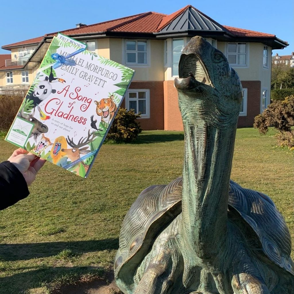 Beside a tortoise sculpture - Book fairies hide Michael Morpurgo's A Song of Gladness around the UK