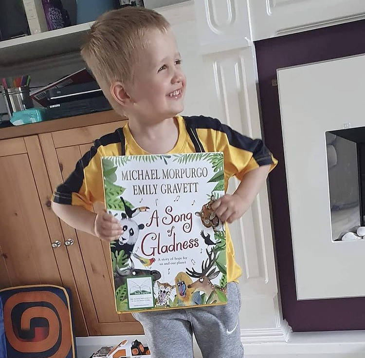 A happy book finder - Book fairies hide Michael Morpurgo's A Song of Gladness around the UK