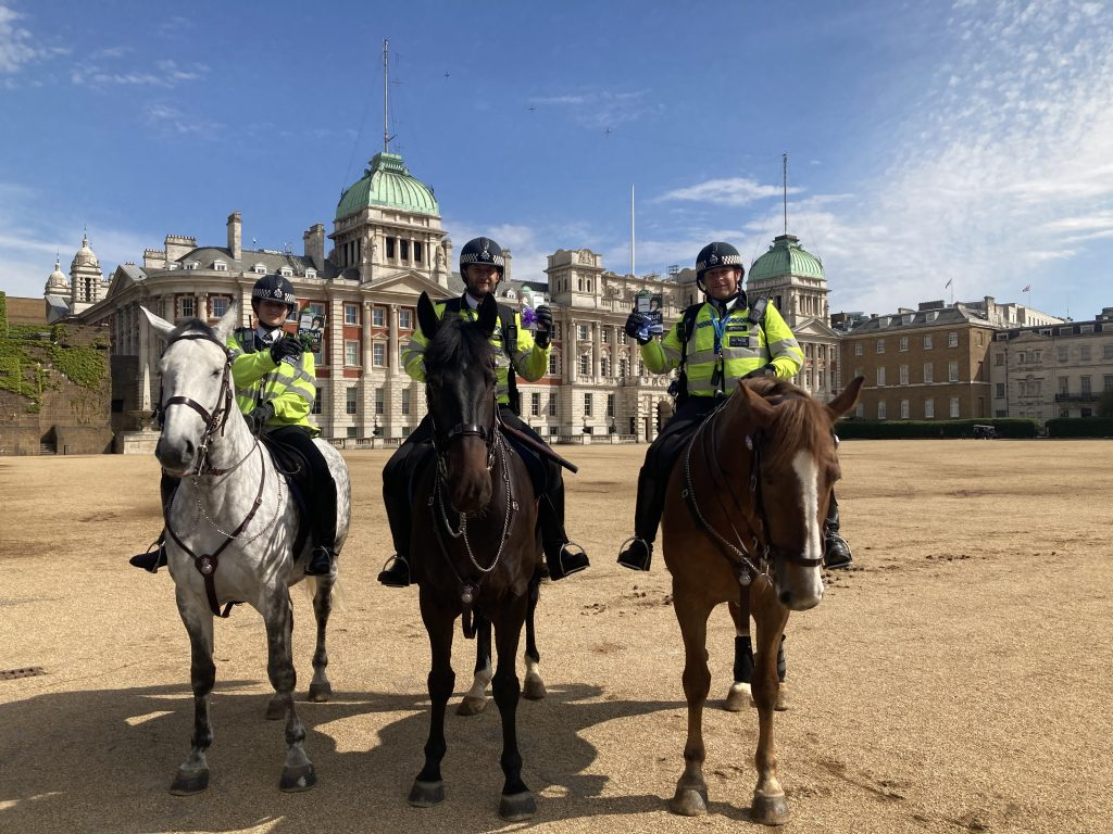 Mounted Police with books - Book Fairies hide copies of The Pursuit of Love for BBC drama