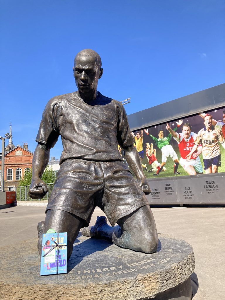 Book Fairies leave copies of Jaz Santos vs The World on paperback release day - waiting by Thierry Henry statue