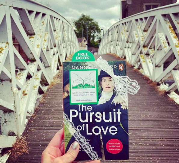At a bridge - Book Fairies hide copies of The Pursuit of Love for BBC drama