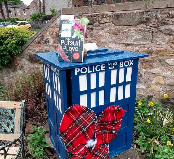 At a little library in Edinburgh - Book Fairies hide copies of The Pursuit of Love for BBC drama
