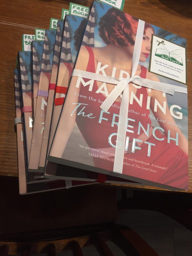 Preparing beautiful books - The Book Fairies in Australia hide copies of The French Gift by Kirsty Manning