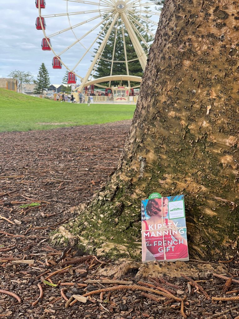 By the big wheel - The Book Fairies in Australia hide copies of The French Gift by Kirsty Manning
