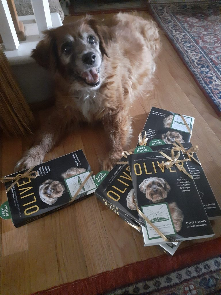 Posing with the books! Book Fairies around the states hide copies of Oliver the dog