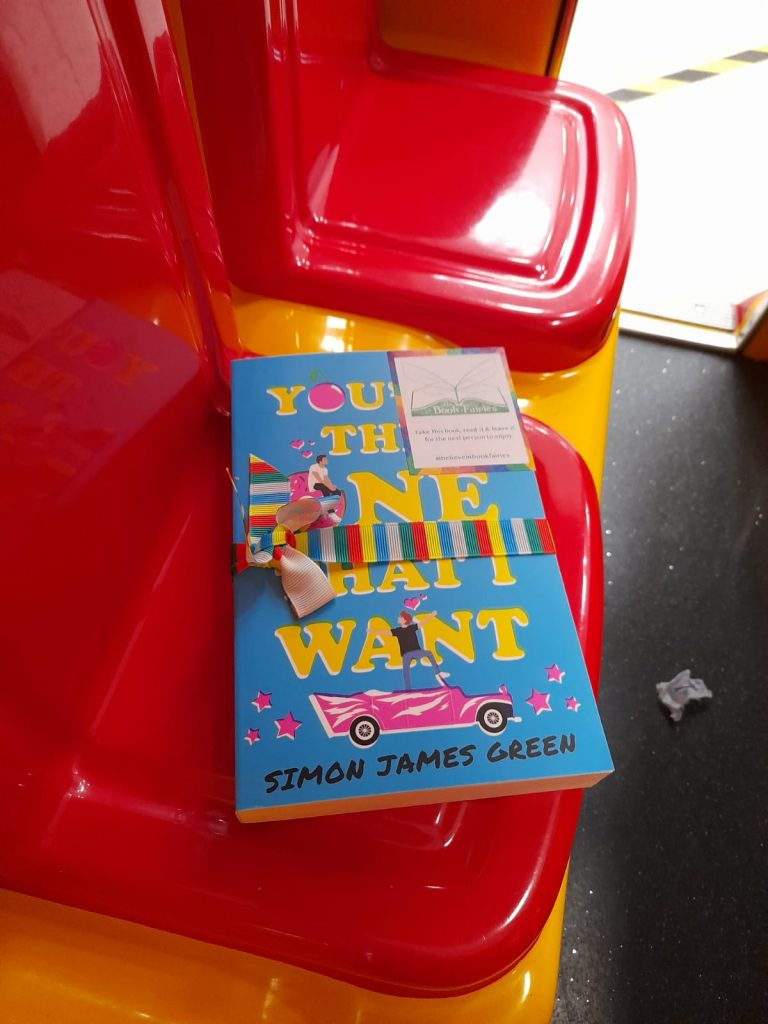 Book Fairies share Simon James Green's novel You're The One That I Want as part of Pride on a red chair