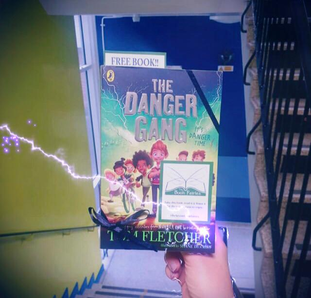 Book Fairies share copies of The Danger Gang by Tom Fletcher at a school