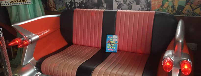 Book Fairies share Simon James Green's novel You're The One That I Want as part of Pride at a diner
