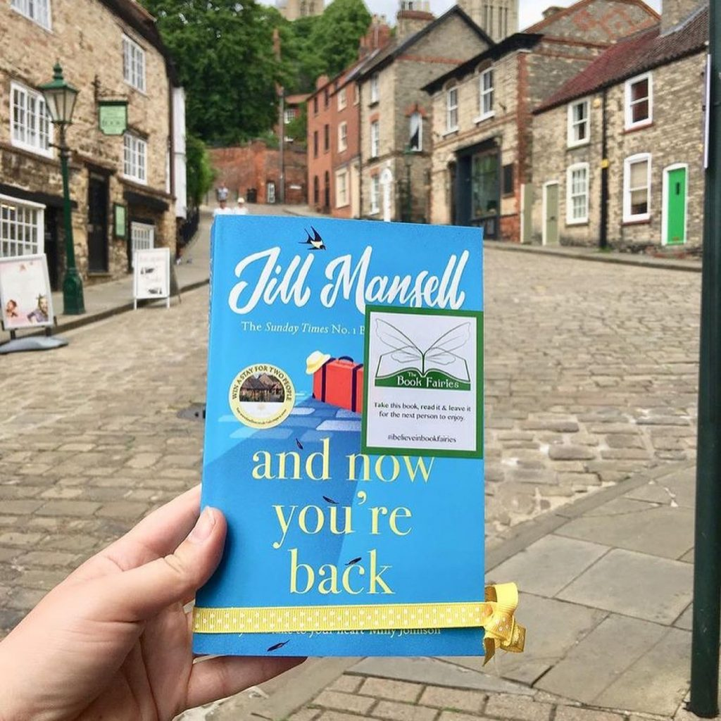 The Book Fairies and Jill Mansell share copies of And Now You're Back in Lincoln