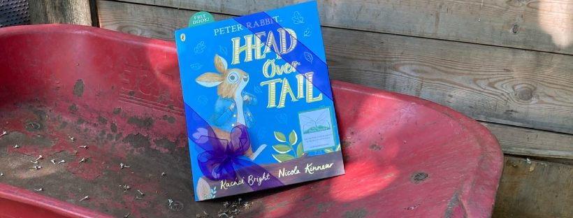 New Peter Rabbit adventure Head Over Tail shared by book fairies in a wheelbarrow