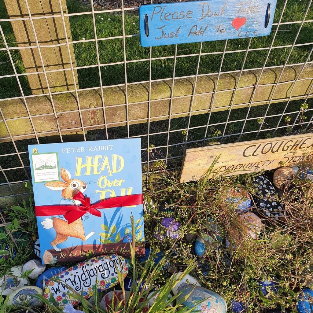 New Peter Rabbit adventure Head Over Tail shared by book fairies near a kindness rock