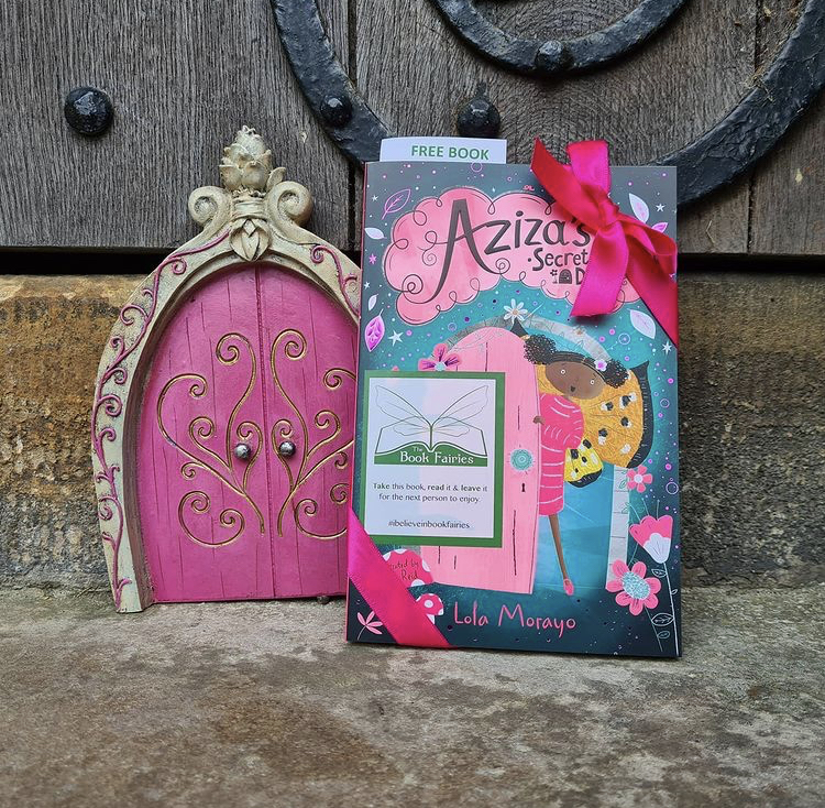 Aziza and the Secret Fairy Door hidden by Book Fairies at a gate