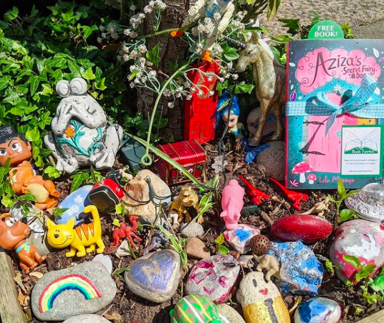 Aziza and the Secret Fairy Door hidden by Book Fairies at a fairy tree