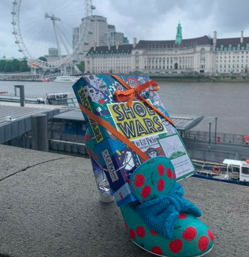 The Book Fairies share copies of Shoe Wars around the UK in London