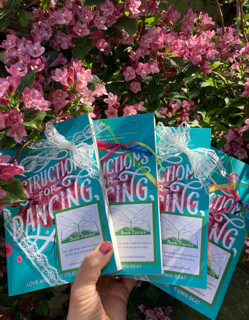 Nicola Yoon's new novel Instructions for Dancing hidden by The Book Fairies - with flowers